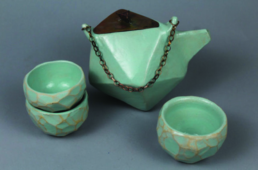 Chandler Drake (12) won a Gold Key for his ceramic teapot and cups.