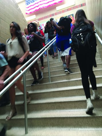 North Star students travel up and down the staircase on their way to class. With approximately 2,200 students enrolled this school year, hallways have become congested. Student Council is considering multiple measures to help keep traffic flowing. Photo by Olyvia Hillman/GG Staff
