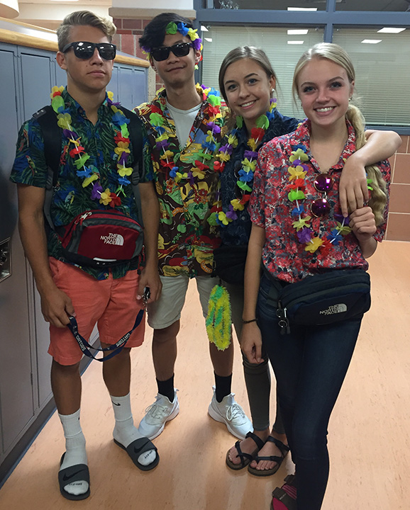 Ethan Wobken (11),  Johnny Nguyen (11), Jordyn Becwar (10), and Paige Svehla (10) dress for vacation on Tacky Tourist Tuesday. Photo by Olivia Kriz/GG Staff