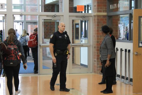 School Resource Officer, Shane Jensen looks to the camera shortly after announcing that the lockout can be lifted.