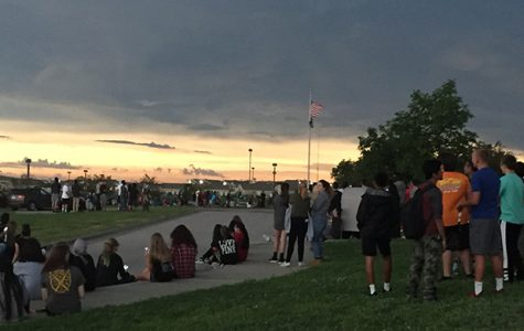 Sun creeps back to the horizon after the solar eclipse on Aug. 24. Cloud cover in north Lincoln made it difficult to see totality. Photo by Christina Nevitt / GG Advisor