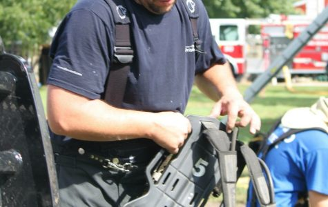 A volunteer firefighter with the Valparaiso Rural Fire Department organizes equipment during training. Courtesy Photo
