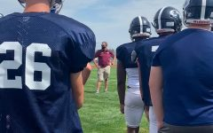 Head coach Tony Kobza addresses his team during practice on Thursday, Aug. 19.