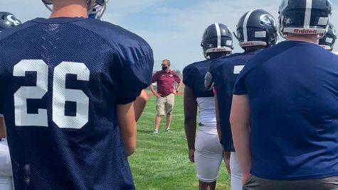 Head coach Tony Kobza addresses his team during practice on Thursday, Aug. 19.