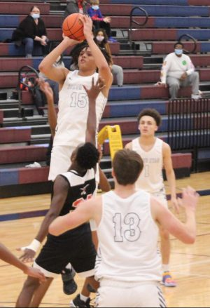 Sophomore Brennon Clemmons, Jr. goes up for a shot during the Gator's game against Lincoln High.